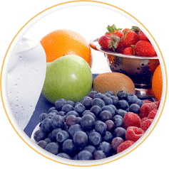 Collection of fruit including blueberries, raspberries, apples, oranges, and strawberries