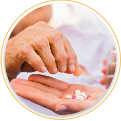 Person placing medicine pills into another person's hand