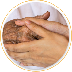 Two people embracing hands
