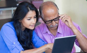 Woman and man starting at laptop
